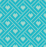 Seamless pattern on the theme of holiday Valentine`s Day with an image of the Norwegian and fairisle patterns. Light hearts on a t Royalty Free Stock Photo