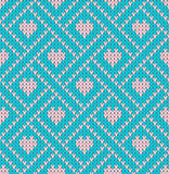 Seamless pattern on the theme of holiday Valentine`s Day with an image of the Norwegian and fairisle patterns. Pink hearts on a tu Stock Image