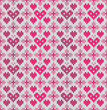 Seamless pattern on the theme of holiday Valentine`s Day with an image of the Norwegian and fairisle patterns. Pink hearts on a wh Royalty Free Stock Photo