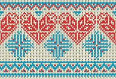 Seamless pattern on the theme of holiday Valentine`s Day with an image of the Norwegian and fairisle patterns. Red heart, turquois Royalty Free Stock Image