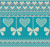Seamless pattern on the theme of holiday Valentine`s Day with an image of the Norwegian and fairisle patterns. White bows and hear Royalty Free Stock Photography