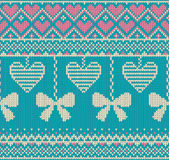Seamless pattern on the theme of holiday Valentine`s Day with an image of the Norwegian and fairisle patterns. White bows and hear Stock Photo
