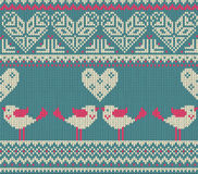 Seamless pattern on the theme of Valentine's Day with an image of the Norwegian patterns and hearts. Figure showing Stock Photos