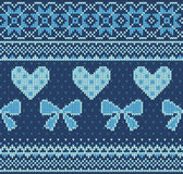 Seamless pattern on the theme of Valentine's Day with an image of the Norwegian patterns and hearts. Wool knitted Stock Image