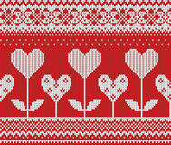 Seamless pattern on the theme of Valentine's Day with an image of the Norwegian patterns and hearts. Wool knitted Stock Images