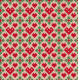 Seamless pattern on the theme of Valentine's Day with an image of the Norwegian patterns and hearts. Wool knitted Royalty Free Stock Images