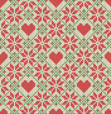 Seamless pattern on the theme of Valentine's Day with an image of the Norwegian patterns and hearts. Wool knitted Royalty Free Stock Image