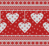 Seamless pattern on the theme of Valentine's Day with an image of the Norwegian patterns and hearts. Wool knitted Stock Photos