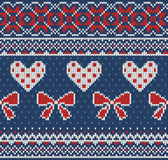 Seamless pattern on the theme of Valentine's Day with an image of the Norwegian patterns and hearts. Wool knitted Royalty Free Stock Photography