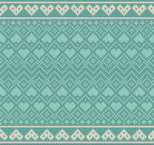 Seamless pattern on the theme of Valentine's Day with an image of the Norwegian patterns and hearts. Wool knitted Stock Photography