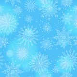 Seamless illustration on the theme of winter and winter holidays, the contour of the snowflake and flare, white snowflakes on a bl. Seamless pattern on the theme Royalty Free Stock Image