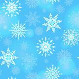 Seamless illustration on the theme of winter and winter holidays, the contour of the snowflake and flare, white snowflakes on a bl Royalty Free Stock Image
