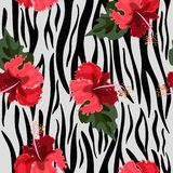 Seamless pattern with tiger skin and hibiscus flowers. Vector texture vector illustration