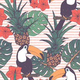 Seamless pattern with toucans pineapple and tropical leaves Royalty Free Stock Photos