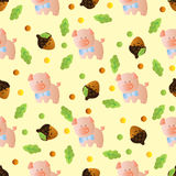 Seamless pattern with toy baby pig. And green leaves on a light yellow background Stock Images