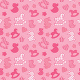 Seamless pattern with toys - horses, rabbits, hearts and stars. Royalty Free Stock Images
