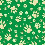Seamless pattern of traces of dog`s paws.  Stock Image