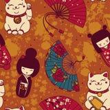 Seamless pattern with  traditional asian souvenirs^ hand paper fans, kokeshi dolls, maneki neko and sakura flowers Stock Photo