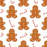 Seamless pattern with traditional Christmas homemade gingerbread man cookies and candy on white background. Vector food concept. For banner, poster, wallpaper Stock Images