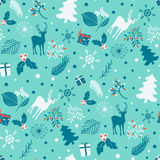 Seamless pattern with tree, leaves and  deer on a blue background. Stock Photo