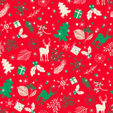 Seamless pattern with tree, leaves and  deer on a red background. Royalty Free Stock Image
