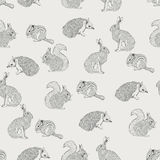 Seamless pattern with trees, shrubs, foliage, animals on light background in vintage style. Royalty Free Stock Image