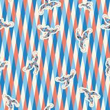 Seamless pattern triangle, clown hats. Seamless pattern of white, dark blue, red triangles on a white background  with the clown hats Stock Photography