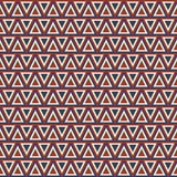 Seamless pattern with triangles. Geometric background in blue and red colors Royalty Free Stock Image