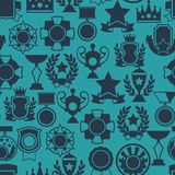Seamless pattern with trophy and awards in flat Stock Images