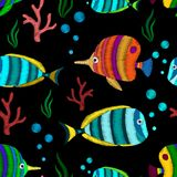 Seamless pattern with tropical fish. Decorative seamless pattern with tropical fish stylized texture of embroidery. Vector pattern for printing on fabric Royalty Free Stock Photo