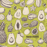 Seamless pattern with tropical fruits on light green background Stock Image