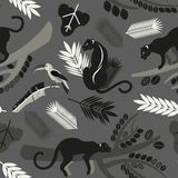 Seamless pattern with tropical leaves, branches of trees, jaguars and toucans. Flat style. Royalty Free Stock Photography