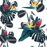Seamless pattern with tropical leaves and exotic flowers. Blue palm leaves and exotic flowers on the white background. Vector seamless pattern. Tropical vector illustration