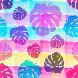 Seamless pattern of tropical leaves on the watercolor stripped background. vector illustration