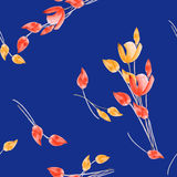 Seamless pattern of tulips with yellow and red flowers on a deep blue background. Watercolor royalty free stock photography