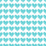 Seamless pattern with turquoise hearts Stock Images