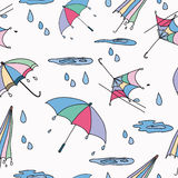 Seamless pattern umbrella. Seamless pattern from umbrellas, puddles, rain in a color on a white background Royalty Free Stock Images