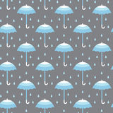 Seamless pattern with umbrellas. Seamless pattern with blue umbrellas on gray background in vector Stock Image