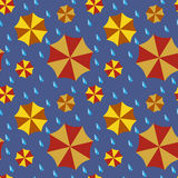 Seamless pattern - umbrellas and drops of a rain. Royalty Free Stock Photos
