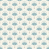 Seamless pattern with umbrellas and rain drops. Stock Photos