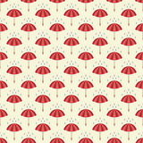 Seamless pattern with umbrellas and rain drops. Stock Images
