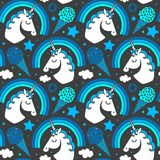 Seamless pattern with unicorn and rainbow on dark background. Vector cartoon style character Stock Images