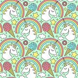 Seamless pattern with unicorn and rainbow on green background. Vector cartoon style character Royalty Free Stock Photos