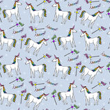 Seamless pattern with unicorns and magic wands Royalty Free Stock Images