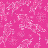 Seamless pattern with unicorns stock photography