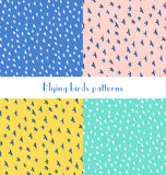 Seamless pattern with various flying birds on a blue, yellow, pi Stock Image