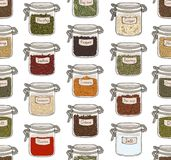 Seamless pattern with various ground spices or piquant condiments stored in glass jars on white background. Hand drawn. Vector illustration for wallpaper Royalty Free Stock Images