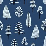 Seamless pattern with various hand drawn winter trees covered by snow on blue background. Backdrop with cartoon snowy. Forest. Modern vector illustration for vector illustration