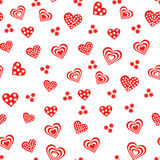 Seamless pattern with various red and white hearts Stock Photos