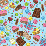 Seamless pattern from various sweets on blue background Stock Image